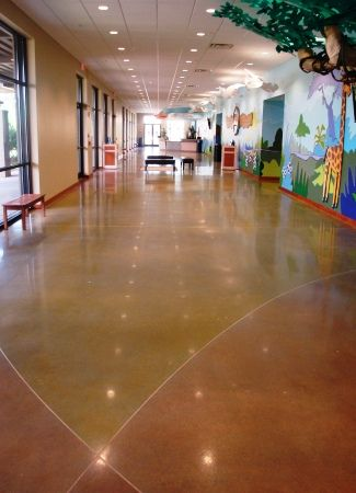 Dyed concrete floors using powdered nd liquid acetone based dyes.
